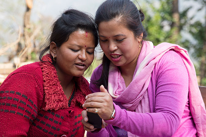 Kalpana Shrestha (left) has received psychosocial counselling for her trauma, from counsellors including Juni as well as Situ (right), pictured here in Sanosirubari VDC -2 in Chautara, Sindhupalchwok, Nepal. Photo: UN Women/N. Shrestha