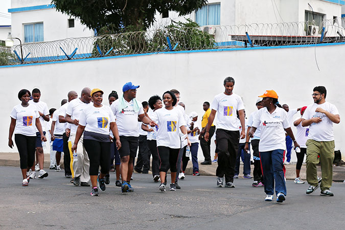Every Saturday in Liberia, partners, friends and staff of UN Women and other UN agencies join together on a Wellness Walk around the Liberian capital, Monrovia. On her visit to Liberia, UN Women's Executive Director joined the team for their warm-up exercises. Photo: UN Women/Stephanie Raison