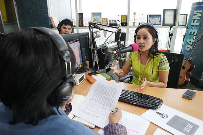 In Indonesia, a radio talk show on gender equality answered questions from listeners. Photo: UN Women