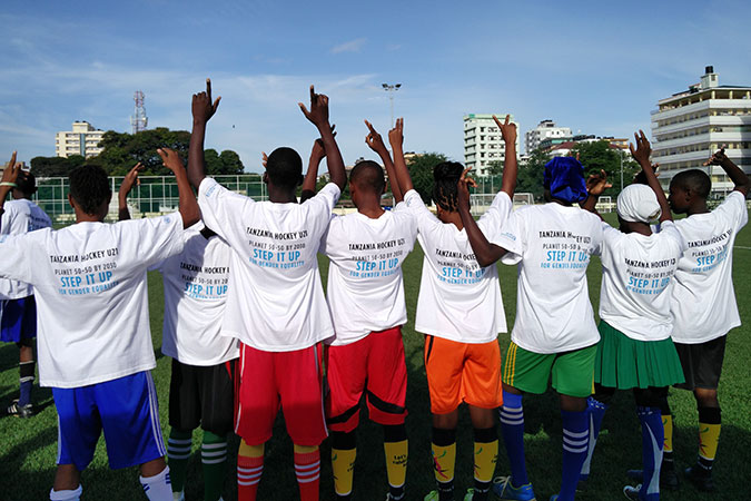 Tanzania's National Under 21 Hockey team gets ready for a mixed hockey tournament to celebrate International Women's Day. Photo: UN Women/Deepika Nath