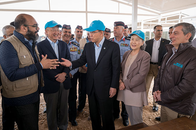 "From left to right, Mohammad Naciri, UN Women's Regional Director for Arab States, Jim Yong Kim, Director of the World Bank, Ban Ki-moon, Secretary-General of the United Nations, and Mr. Ban's wife, Ms. Yoo (Ban) Soon-taek, during a visit to one of UN Women's ""Oases"" in Za'atari refugee camp. Photo: UN Women/Christopher Herwig"