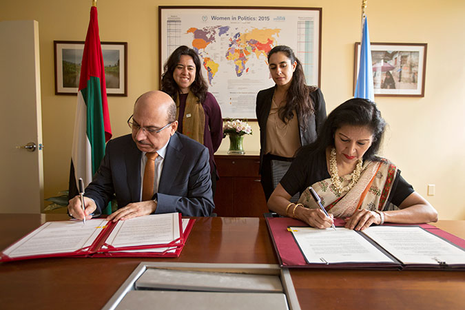 UN Women Deputy Executive Director Lakshmi Puri and UAE Assistant Minister for Legal Affairs Abdulrahim Yousif Al Awadi sign an agreement between UN Women and UAE to open a new UN Women Liaison Office in Abu Dhabi on 15 July. Photo: UN Women/Ryan Brown