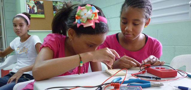 In the Dominican Republic, girls as young as 11 are taking classes in robotics, auto-mechanics, computer programing and electronics. Photo courtesy of the Fund for Gender Equality