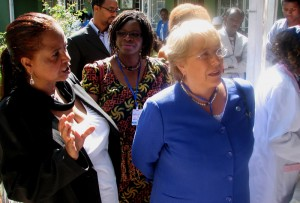 Director Maria Munir Yusuf (far left) leads Ms. Bachelet (right) on a tour of her gender-based violence centre for poor women in Addis Ababa.
