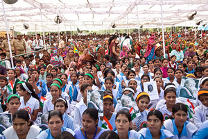 Men and women gather to promote the rights of girls and education for all