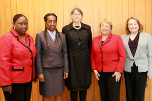 Pictured from left: Claire Carlton-Hanciles, Chief Defender of the Court; Court Registrar Binta Mansaray; Prosecutor Brenda Hollis; Ms. Bachelet; and Justice Shireen Avis Fisher, President of the Court.