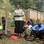 At a meeting of the Cocamu Coffee Cooperative, Euphrasia Musabyemariya explains how life has improved since she became a member.